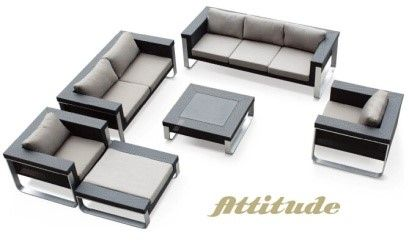 Wicker. The ultimate in luxury. Seven seats, one ottoman, one glass top coffee table. Super stylish.