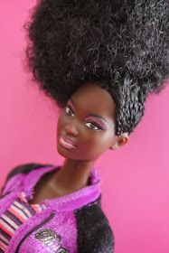 Natural Doll with Side Cornrows & Afro - $70 This beautiful doll is rockin' some side cornrows and an afro. She's wearing...