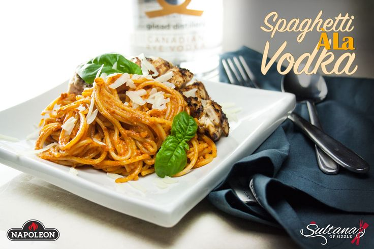 Recipe for pasta in a creamy vodka sauce, topped with grilled chicken and Parmesan cheese.