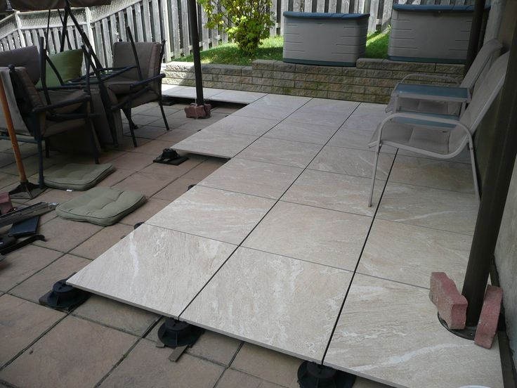 2Thick Stonewave Warm 24x24 exterior porcelain tile. Floating patio installed with screwjack pedestals.
