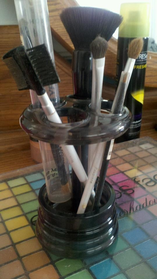 Organize make up brushes in a toothbrush holder.