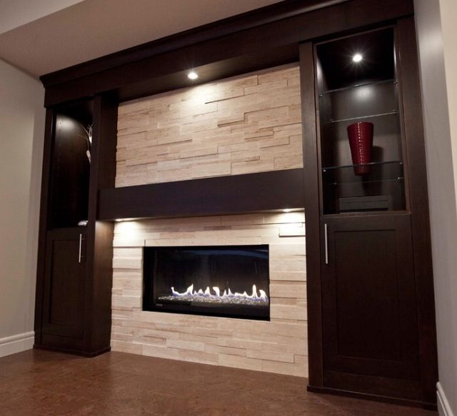 Ideas for contemporary fireplace with built-ins and TV nook.  Love the light, stacked stones and the dark built-ins.