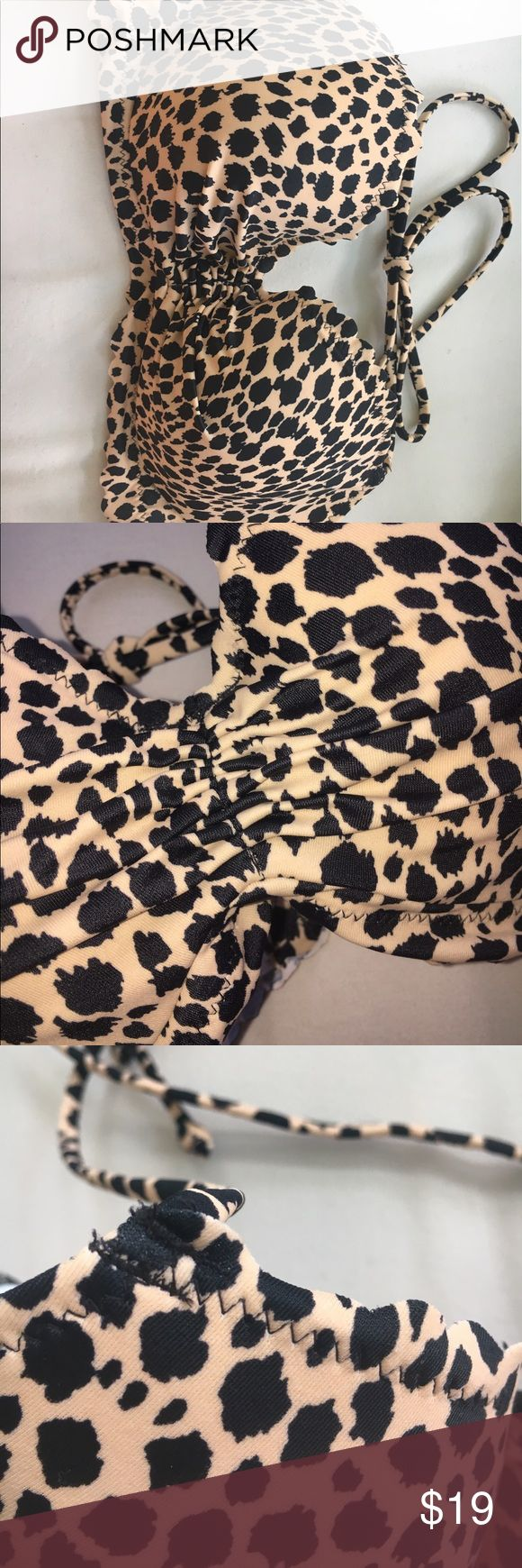 VS Leopard Print Bikini Top Perfect condition. No flaws besides thread snags. 80% polyamide 20% elastane. I don't recall ever wearing this besides trying it on. Amazing feel. Ruffle in the middle. Overall cute bathing suit top, and comfy! Lightly lined with underwire Victoria's Secret Swim Bikinis