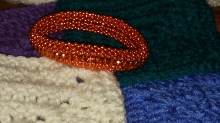 """Love Triangle"" bangle. Pattern by Shelley Nybakke. 8/0 Galvanized Saffron and 4mm ""Halo Sandalwood"" Fire Polished Czech"