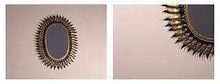Espejo ovalado de rayos bicolores (aunque el lacado negro se podría quitar). Buen estado (el cristal tiene varios puntos, muestra inequívoca de su añada). Medidas: 40 x 60 cms.