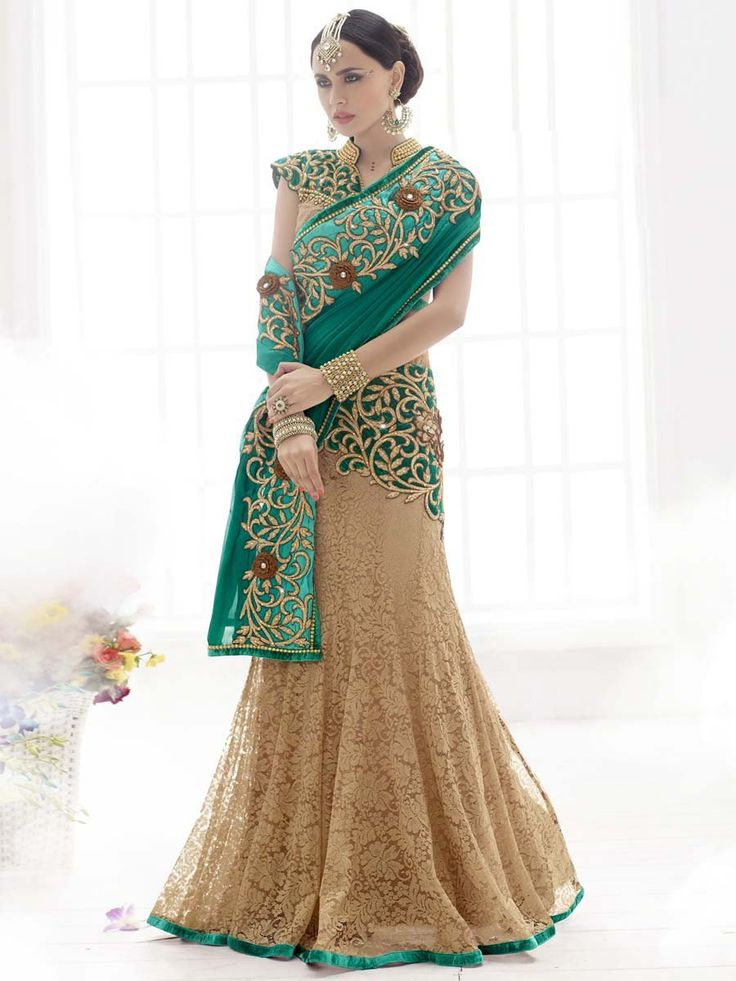 Grandiose beige and teal green color jacquard net and #Chiffon Saree with resham, stone and zari work. Item Code: SAV3820 http://www.bharatplaza.com/new-arrivals/sarees.html