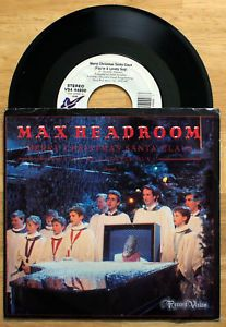 "On the 1986 Christmas Special, #MaxHeadroom sang several songs including #MerryChristmasSantaClaus and #GimmeShades, which were released as a Chrysalis single. #MattFrewer had a Sinatra-like voice, these are the only two songs to be formally released as audio recordings. #Max #Headroom is a fictional artificial intelligence (AI) character, known for his wit and stuttering, distorted, electronically sampled voice, and known as ""The World's first computer-generated TV host."" #Vinyl #LP…"