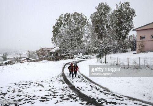 01-19 KARS, TURKEY - OCTOBER 19: Children are seen on the snowy... #sarikamis: 01-19 KARS, TURKEY - OCTOBER 19: Children are… #sarikamis