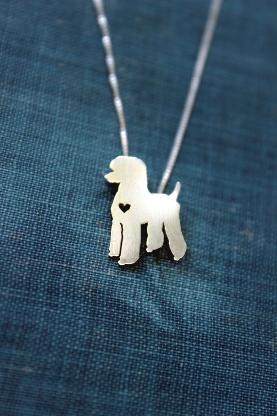 """This tiny Standard Poodle necklace is a perfectly delicate way to keep a loved pet close to your heart. Just ⅝"""" at its largest dimension, our"""