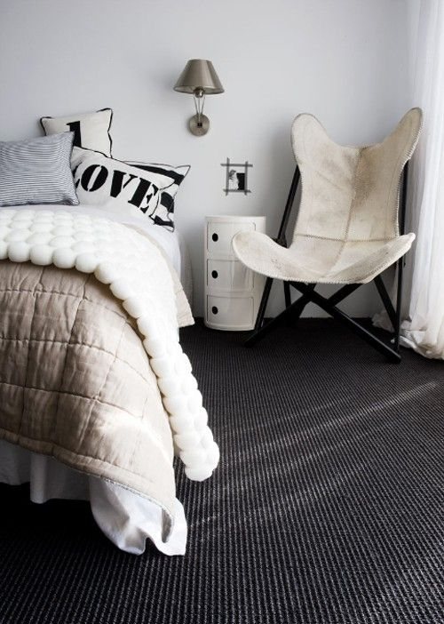 Love the cushions and modern industrial accessories and the charcoal carpet