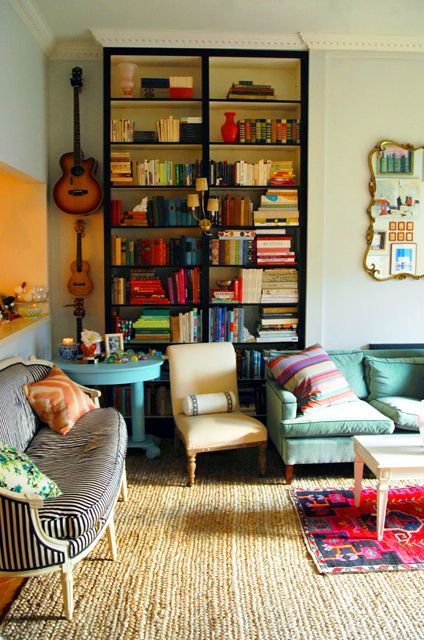 Library, living room. Love the bright colors and instruments on wall.