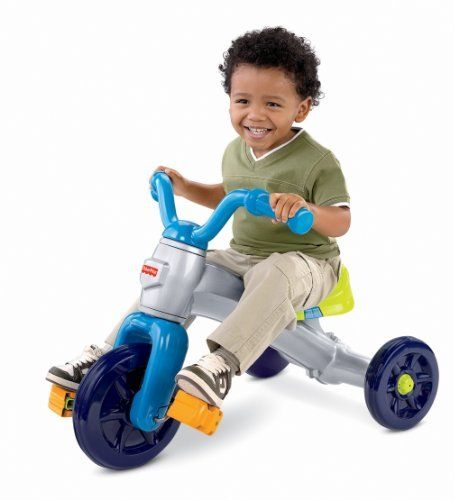"""Fisher-Price Grow With Me Trike by Fisher-Price. $41.95. Features thick handles and pedals for a comfortable ride. Removable pedal blocks for easy foot-to-pedal adjustment. Adjustable seat and pedals. Grow with me trike feature. Your little one will love riding around on this trike. From the Manufacturer                Two-position adjustable seat lets this trike """"grow"""" with kids for years of fun and adventure! With a wide wheel base for stability, slip-resistant p..."""