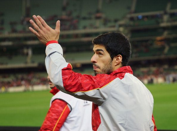Luis Suarez of Liverpool waves to the crowd after the match between the Melbourne Victory and Liverpool at the Melbourne Cricket Ground on July 24, 2013 in Melbourne, Australia