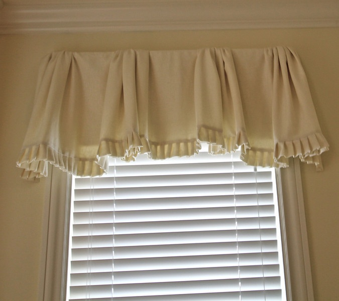 Creamy white linen valance, gathered in sections, pleated ruffle, lined and interlined