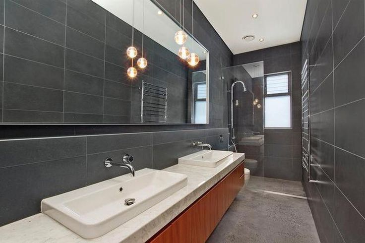 Double bowl Vanity! Stand out bathroom with amazing lighting fixtures that creates a contemporary feel to the space!