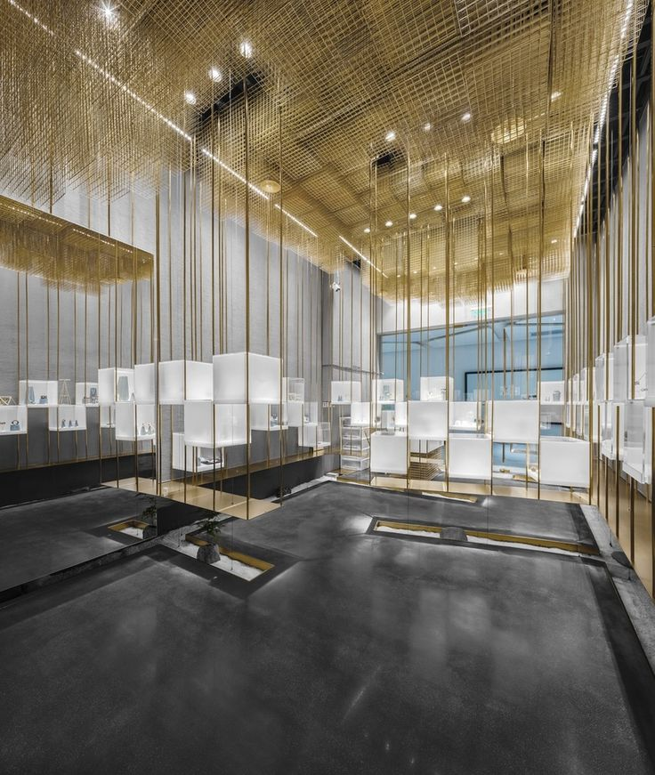 Retail store interiors made with brass wire mesh. #arrowmetal loves this look. Gallery of Store Under the Golden Cloud / Atelier Tree - 5 #brassinterior #wiremesh