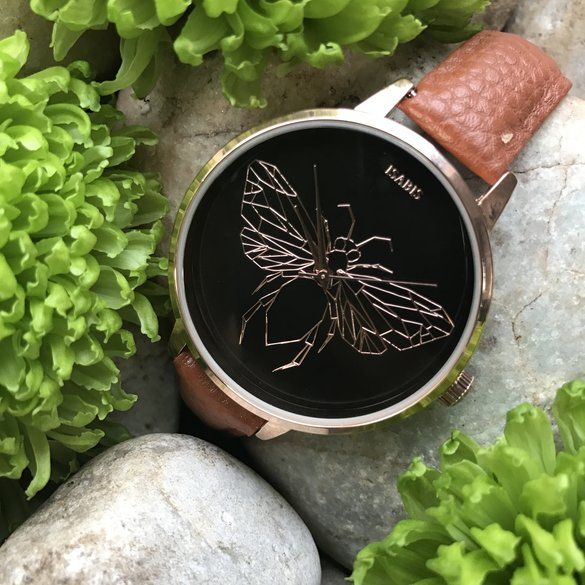 ISABIS WATCH | Hello Pretty. Buy design. An intricately molded bee centered on the dial enhances ISABIS's whimsical style on a beautiful rose gold-plated watch paired with a slim vegan pineapple leather strap. 40mm case; 11mm band width Buckle closure Three-hand quartz movement Mineral crystal face Stainless steel with rose-gold plate/tan pineapple vegan leather Imported