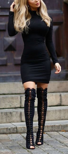 Tight black dress and lace up boots
