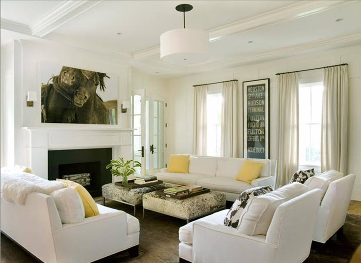 Another Great Example Of Layout With Symmetrical Couches And Two End Chairs