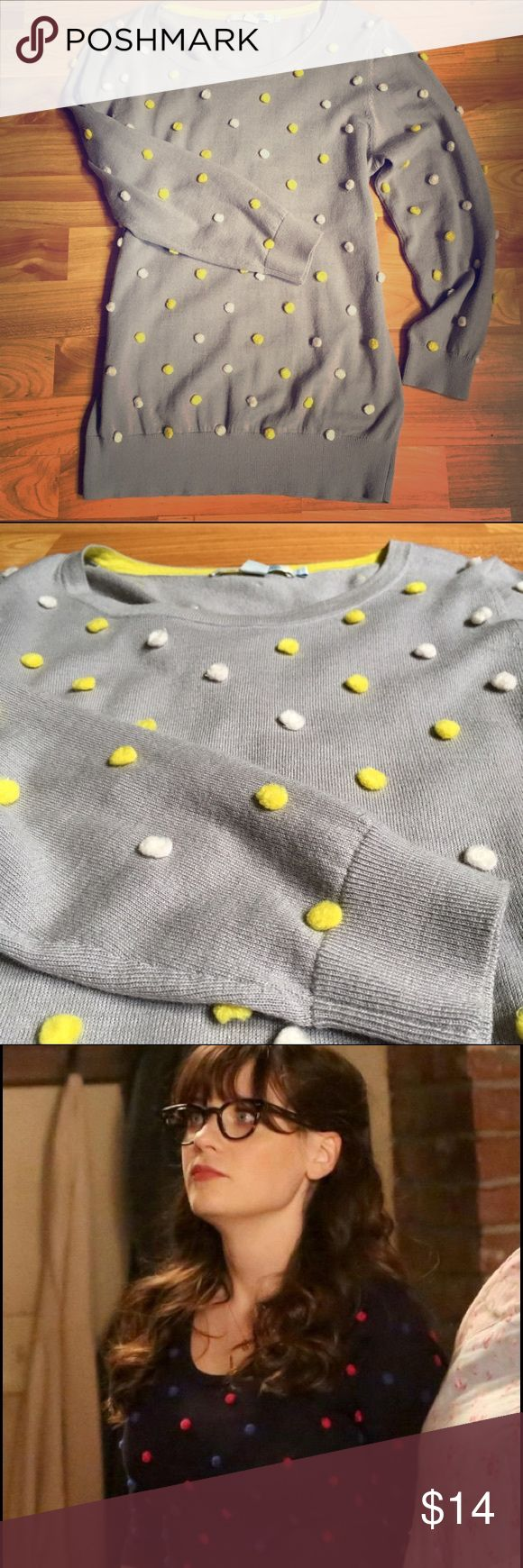 Boden Pom Pom Sweater As Seen On New Girl This Boden Pom Pom jumper is moth grey and features two-tone pom poms (yellow and white) to brighten up a casual outfit. 54% wool 46% cotton. Tag is size 4, but I'm usually a 6-8 and it fits me comfortably. I'm listing as a small. There is a small snag/hole at the bottom of the back, noted in pic #4. Not noticeable when on. Zooey Deschanel wore the same sweater in a different color in an episode of New Girl in March '16 Boden Sweaters Crew & Scoop…