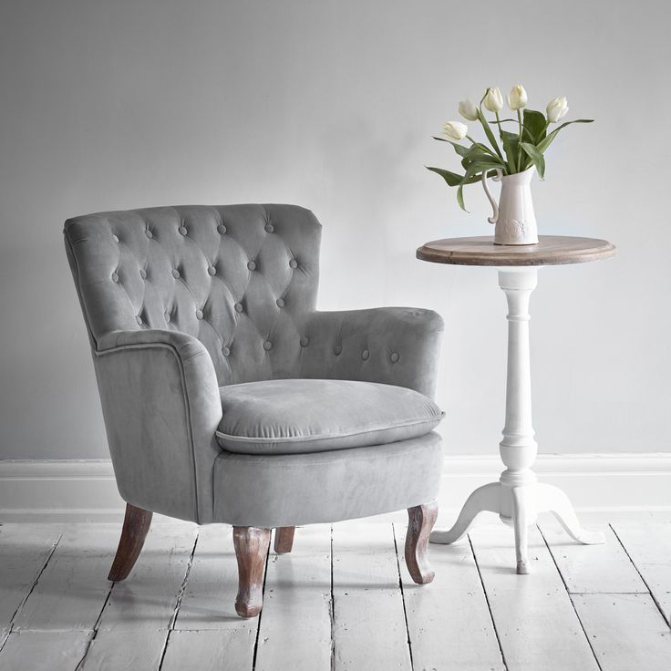 Take a seat in comfort and style. The Roberta Grey is a supremely comfortable, elegantly buttoned chair in grey velvet with distinct cabriole legs. The perfect addition to your living room, pair with a classic side table and contemporary table lamp to complete the look.