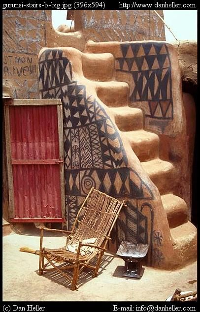 Gurunsi Stairs. On a terrace of an African mud building with beautiful painting.
