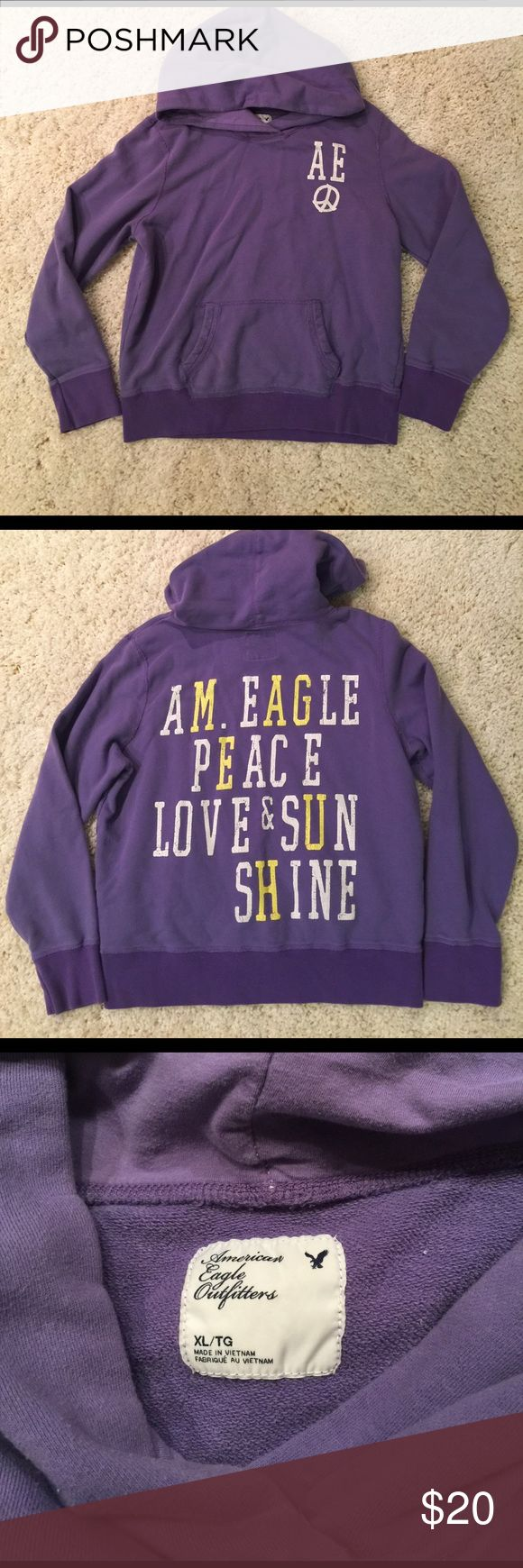 American Eagle Sweatshirt Cozy purple American Eagle sweatshirt. There is cracking in the screen print, but that is how the sweatshirt was designed. The sweatshirt has only been worn a few times and is in great condition. American Eagle Outfitters Tops Sweatshirts & Hoodies