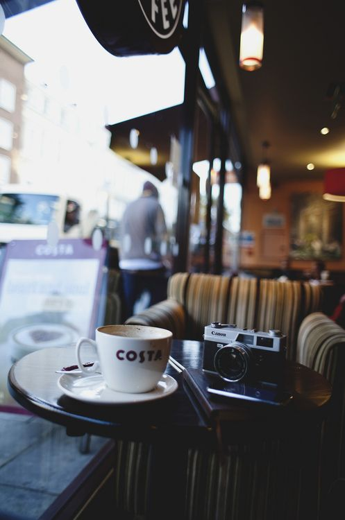 Two of my favorite things; coffee and my camera. Looks like the person who took this photo feels the same :)