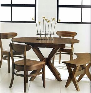 The clean, sleek lines of our Mid Century Modern Vadsco Dining Set will complement every meal.