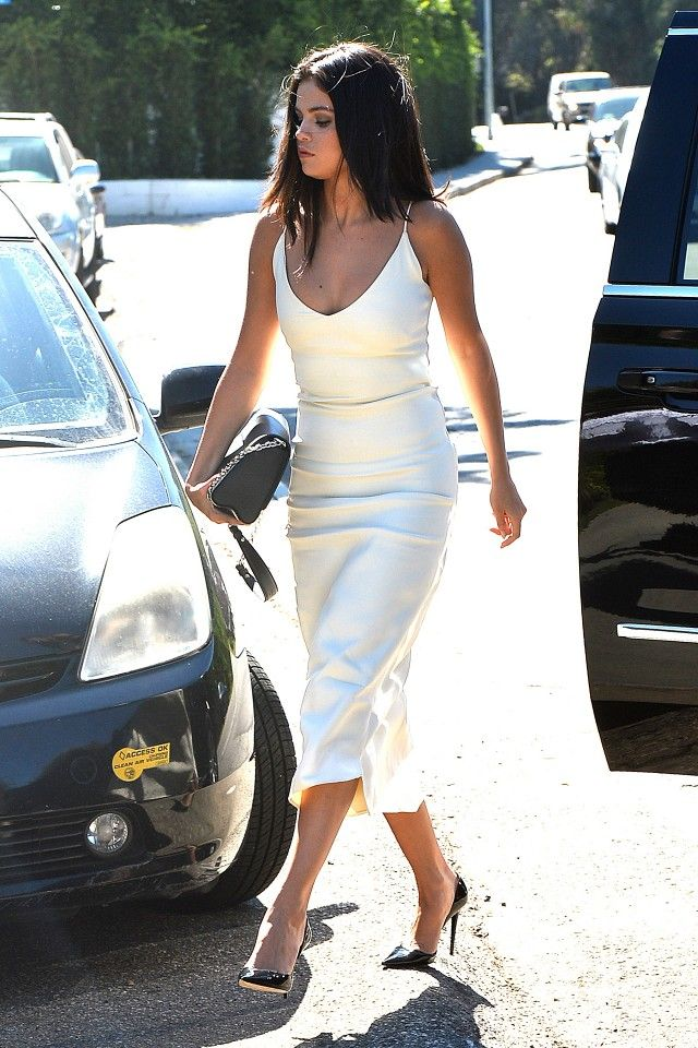 //Selena Gomez wears a white silk Atea Oceanie slip dress