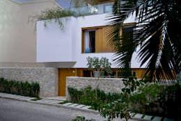 Projekty, nowoczesne Domy zaprojektowane przez Oswaldo Magalhães Filho - PAAL