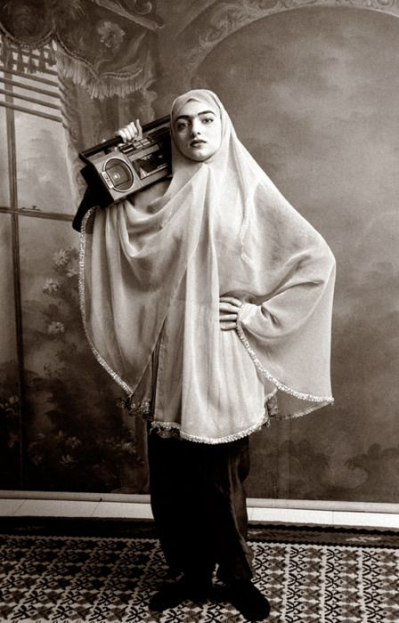 """""""My models are shown wearing clothes from the turn of the 20th century and are carrying objects, mostly smuggled, into contemporary Iran."""" —Shadi Ghadirian"""