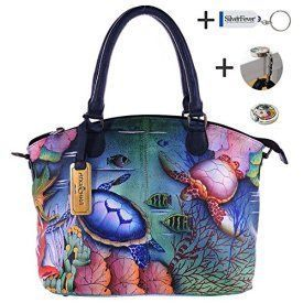 Anuschka Hand Painted Genuine Leather Convertible Satchel (Ocean Treasures) Trendy, Cute and Luxurious Hand Painted Leather Purses Hand painted leather purses are truly eye-catching, unique and cool. In fact they are currently trending like crazy! Obviously when you combine beautiful hand painted art, on fine quality leather the result is a timeless and charming creation just for you.