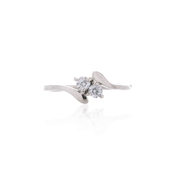Silver double solitaire ring.  http://www.essentialjewellers.com/tiny-sterling-silver-heart-studs-with-cubic-zirconia