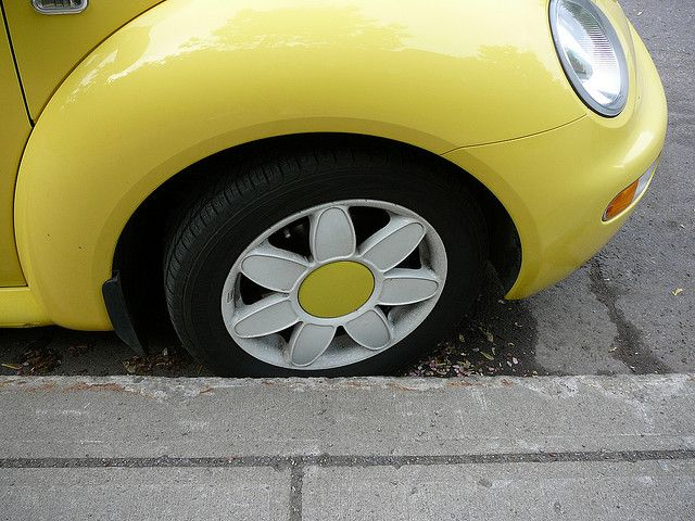 Yellow VW Bug with Daisy Wheels