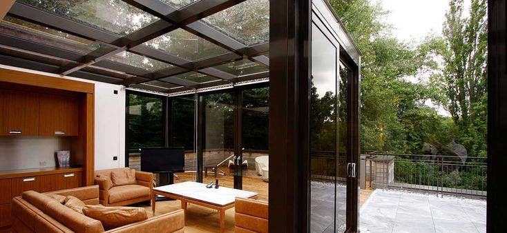 The heavy steel frame was clad in seamless aluminium matched to the sliding doors.