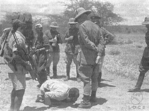 """Ethiopian tribal chief submitting to Italian troops. Italo-Ethiopian war, 1935-36."""