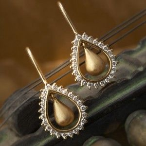 Diamond studded pair of earrings handcrafted in 18k gold.