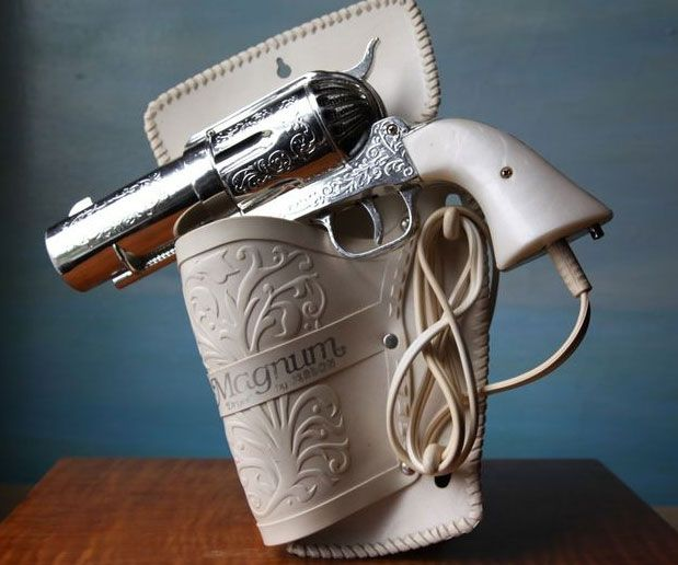 Flirt with danger when you pull out this .357 Magnum gun hair dryer. It is the perfect beauty accessory for true cowgirls who love to pull the trigger on over the top hair styles, and it also makes a cool prop for photos.