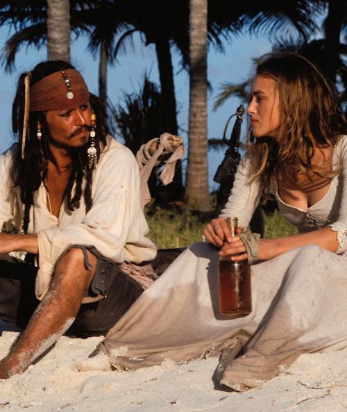 """Captain Jack and Elizabeth ... Yo ho, yo ho, a pirate's life for me! {Johnny Depp and Keira Knightley, """"Pirates of the Caribbean: The Curse of the Black Pearl"""" (2003)}"""
