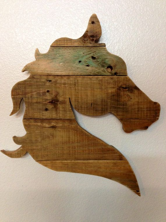 Hand drawn horse head design, hand cut and sanded. Wood is finished with a clear varnish. A hanger will be applied to the back and this beauty