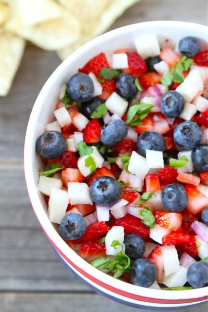 1 cup fresh blueberries  1 cup diced strawberries  1 cup diced jicama  1/3 cup chopped cilantro  1/4 cup finely chopped red onion  2 tablespoons finely chopped jalapeno pepper, stemmed and seeded  Juice of 1 large lime  Salt, to taste  Tortilla chips, for serving