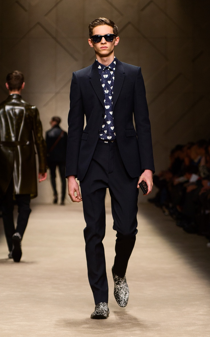 Navy wool mohair suit, heart print shirt and studded iPhone case on the runway of the Burberry A/W13 Menswear show