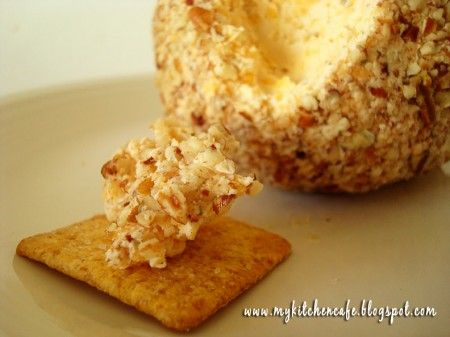 *Makes 4 cheeseballs  INGREDIENTS:  4 (8 ounce) packages cream cheese, softened  4 cups shredded sharp cheddar cheese  1 1/2 teaspoons garlic powder  1 teaspoon dried oregano  2 teaspoons dried parsley  ¼ teaspoon pepper  1 tablespoon Worcestershire sauce  1 tablespoon hot pepper sauce  1 cup pecans, finely chopped for rolling