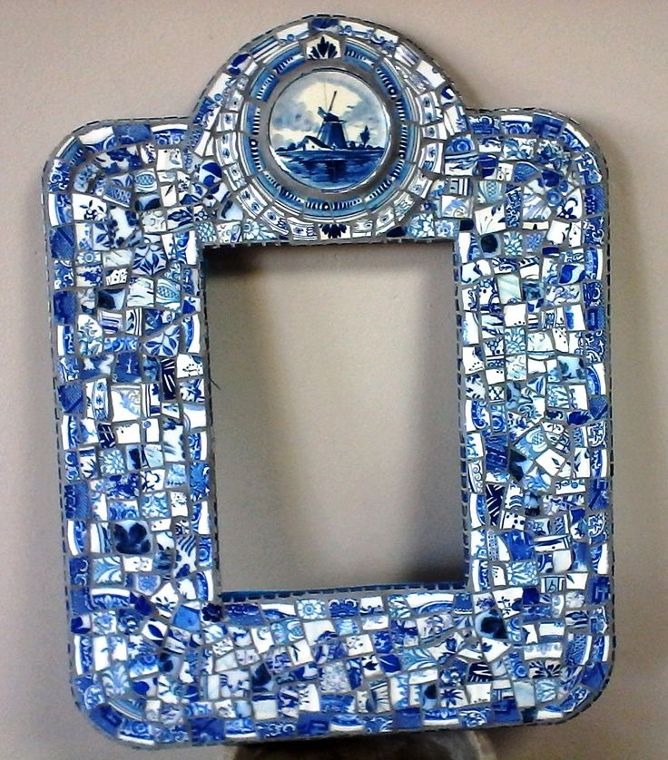 Another pique assiette blue frame. Inspired by the Delft windmill. I love my mosaic mirrors made from broken china. SOLD