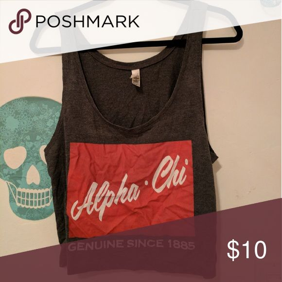 An Alpha Chi Omega tank top An Alpha Chi Omega tank top lettering reads alpha chi genuine since 1855. Tops Tank Tops