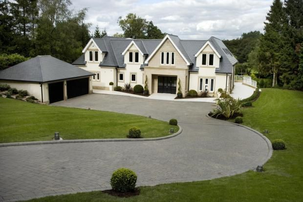 The front my house & way where I park my white Meredes on the drive