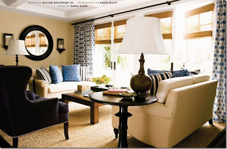 mix printed fabric curtains with textured shades in rooms where all the upholstery is solid fabrics – just like here. The shades and patterned fabric add warmth, coziness, visual interest, and texture.