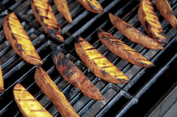Potatoes on the grill - brilliant suggestion to microwave them for a few minutes before you throw them on - quick, easy - delish