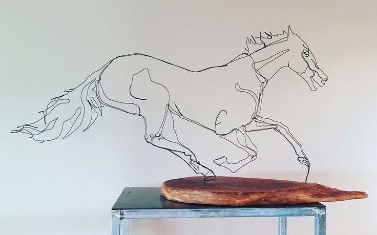 Wire art by Felicity Cavanough  Gallop,  wire and rivergum  Horse racing, black caviar, sculpture